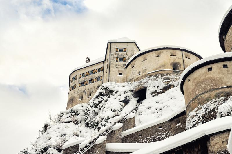 Old medieval european unassailable fortress or castle on hill at alpine austrian Kufstein city covered with big snow. Layer after blizzard in winter. Beautiful stock photos
