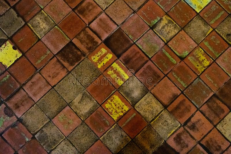 Old medieval floor tiles pattern texture. Background stock photography