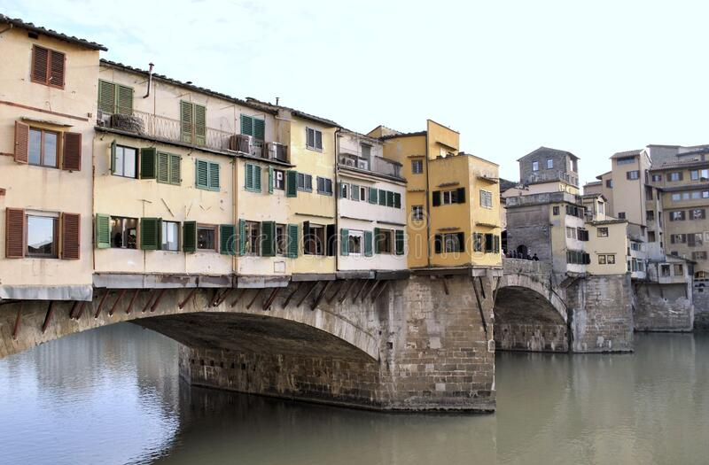 Florence old Italian town medieval buildings urban panorama beautiful cityscape water bridge sky background. Old medieval Italian town Florence city buildings royalty free stock photo