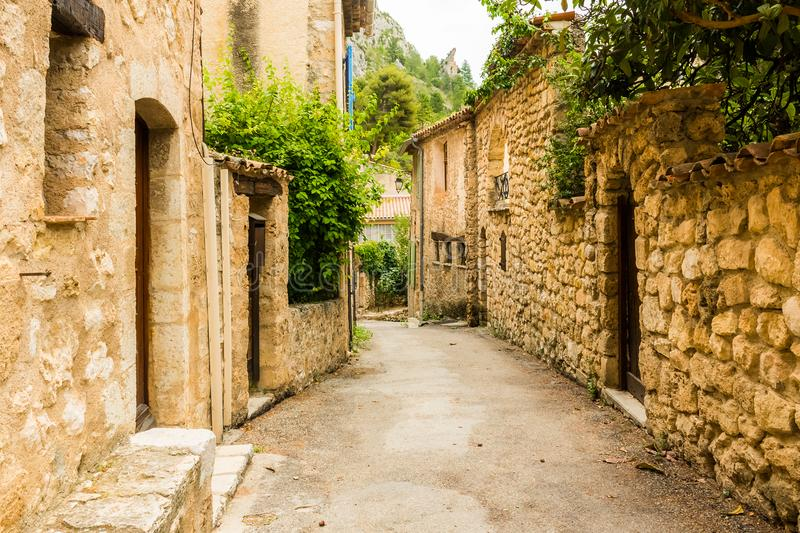 Old medieval street with old houses of charming village Moustiers Sainte Marie, Verdon, Provence, France stock image