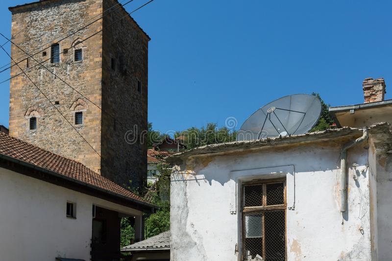 Old Medieval Tower at the center of town of Kratovo, Republic of Macedonia. KRATOVO, MACEDONIA - JULY 21, 2018: Old Medieval Tower at the center of town of stock images
