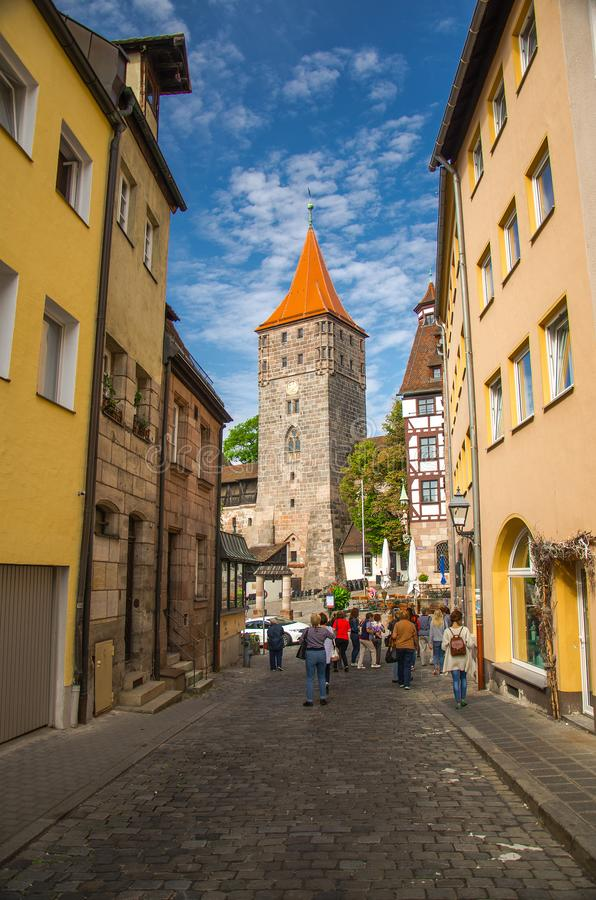 Old medieval Tower Tiergartnertorturm, Nurnberg, Bavaria, German. Old medieval Tower Tiergartnertorturm and traditional buildings on the streets of Nuremberg royalty free stock images