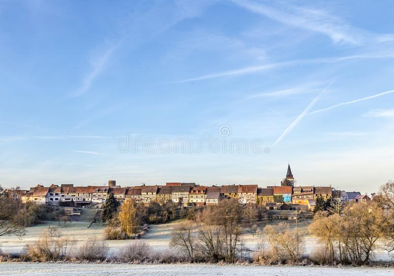 Old medieval town wall build of half timbred houses in Idstein W. Alsdorf in morning light royalty free stock images