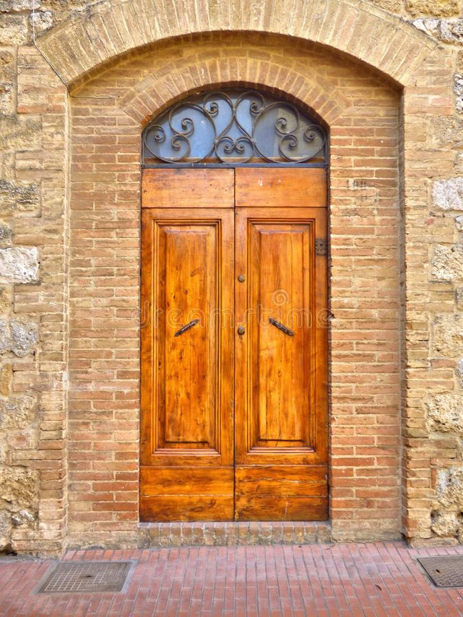 An Old Medieval Wood Door in Tuscany royalty free stock image