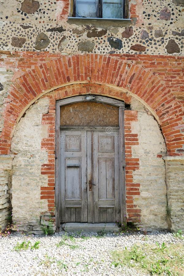 Old medieval wooden door in a stone wall royalty free stock photos