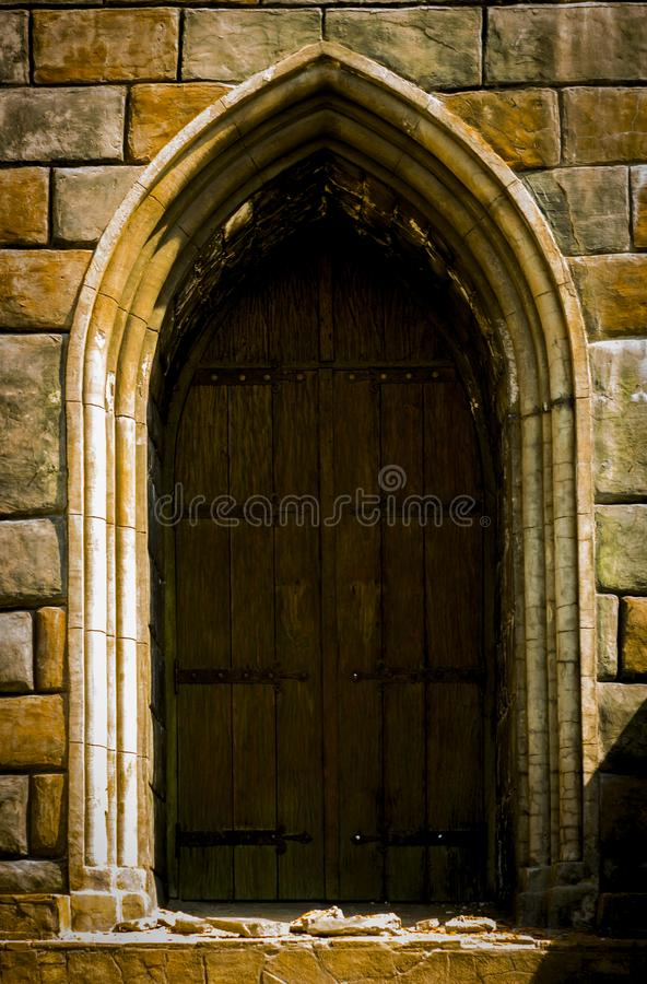 An old medieval wooden door with a studded forged iron frame stock images