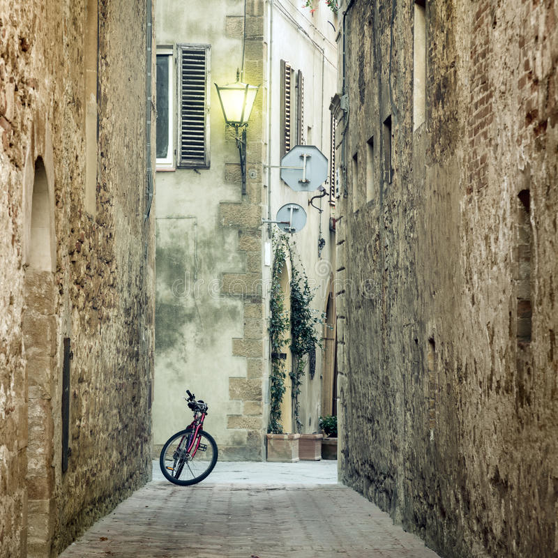 Old Mediterranean Town street with retro bike. Italy, Europe stock photography