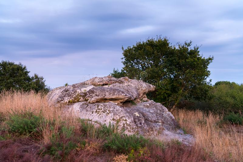 Old megalith in Le Brunet on a sunny evening in summer. Old megalith in Le Brunet France on a sunny evening in summer royalty free stock images