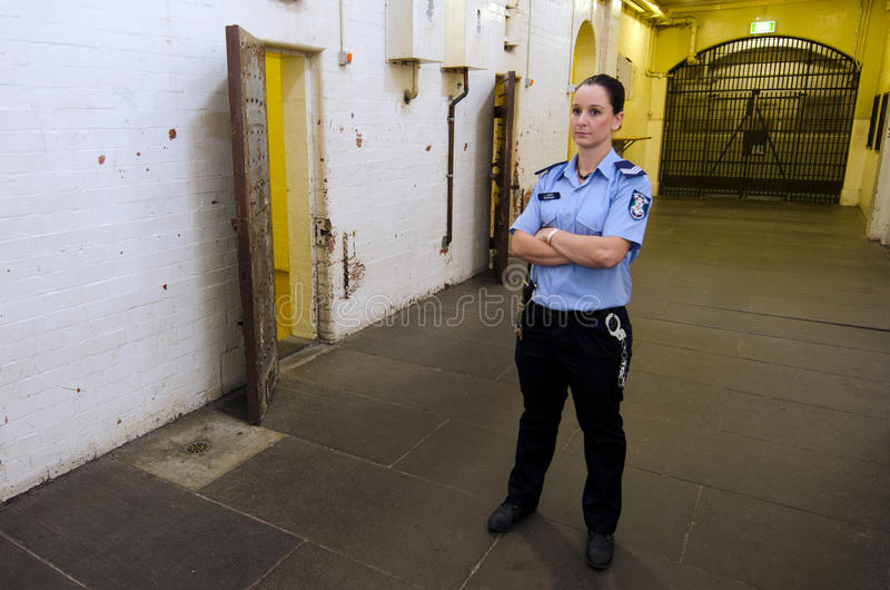 Old Melbourne Gaol. MELBOURNE - APR 11 2014:A woman jailer at the Old Melbourne Gaol, As of 2010, the gaol is recognized as Victoria's oldest surviving penal royalty free stock photography