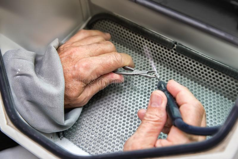 Old men hands working with with tooth prosthesis in a dental sa stock photos