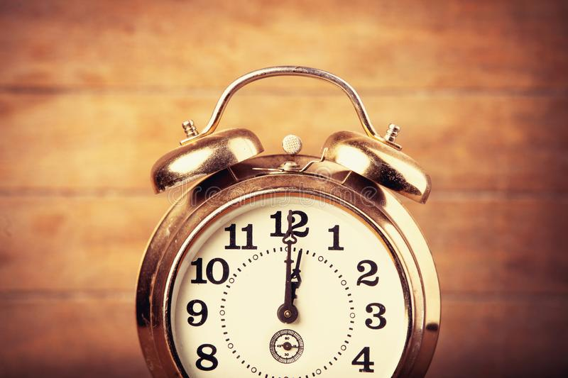 Old metal alarm clock stock photography
