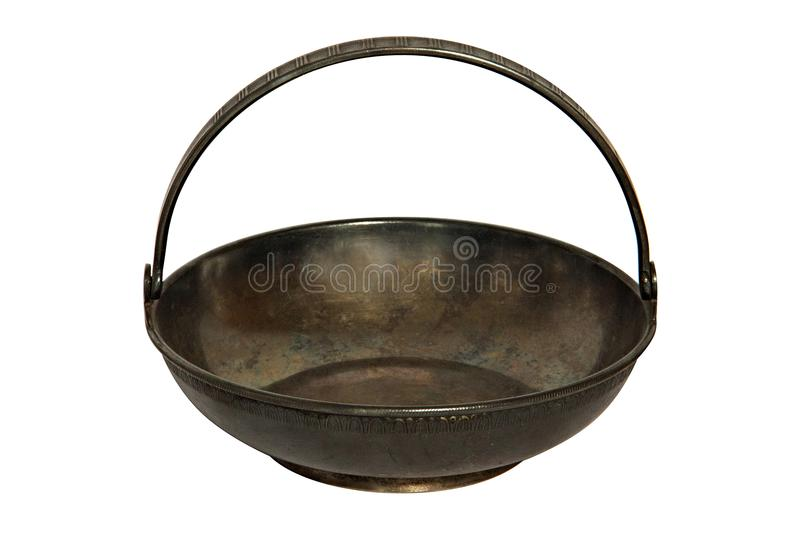 An old metal brass sugar bowl for sugar refined sugar in the form of a flat basket with a handle. Elegant dishes can be used as ca royalty free stock photos