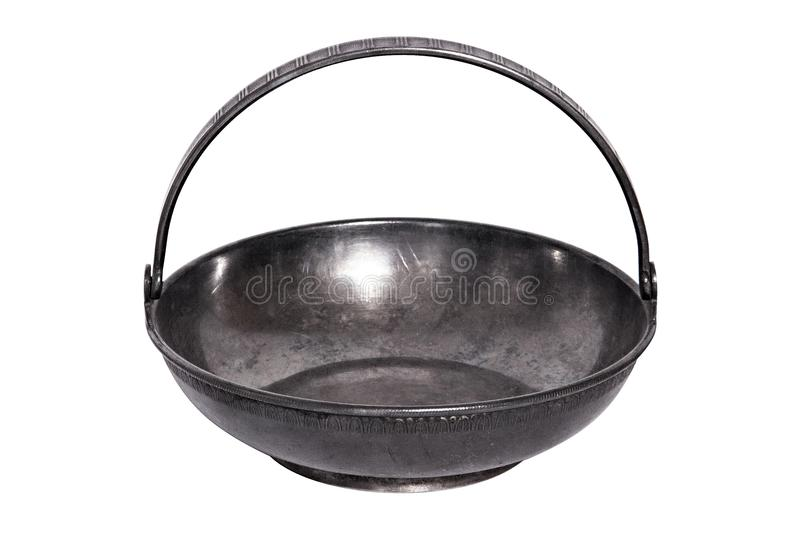 An old metal brass sugar bowl for sugar refined sugar in the form of a flat basket with a handle. Elegant dishes can be used as ca stock photos