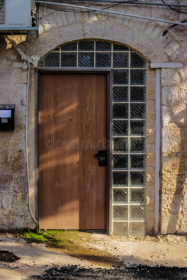 Old metal brown door with window a beautiful vintage background royalty free stock photo