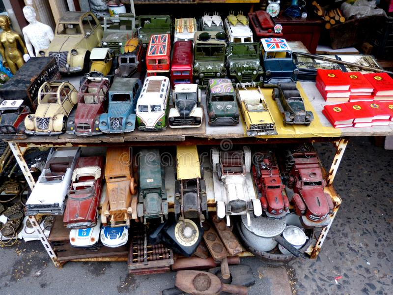 Old metal cars in sale at Dong Tai Lu street antique market in Shanghai China. stock photography