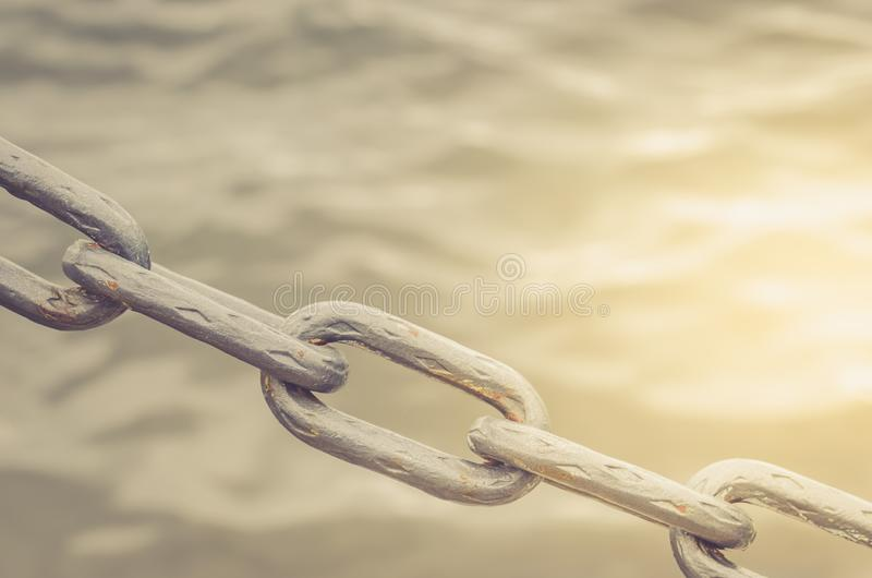 Old metal chain links/old metal chain links on a water background in sunlight. Old metal chain links/ old metal chain links on a water background in sunlight stock images