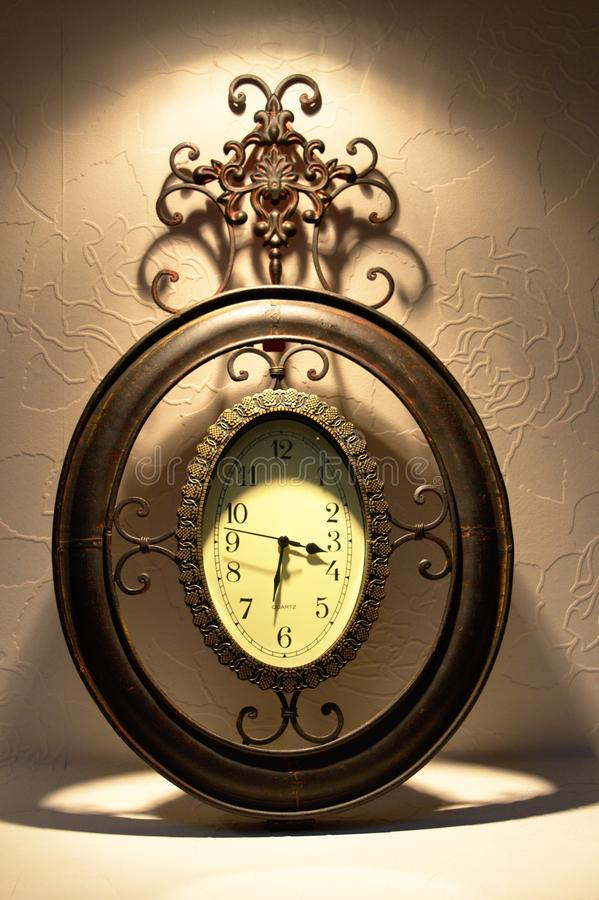 Old metal clock stock image