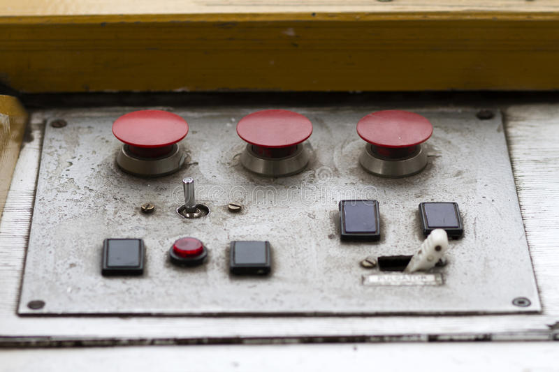 Old Metal Control Panel. With red buttons and switches royalty free stock images