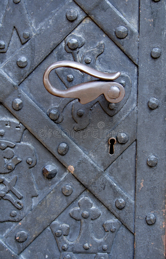 Old metal door with handle.  royalty free stock image