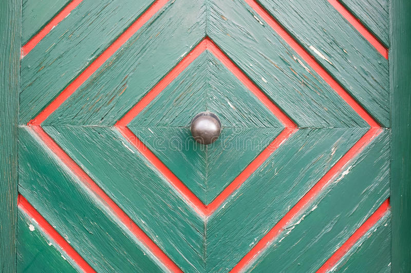 Old metal door knob on a wooden door royalty free stock image