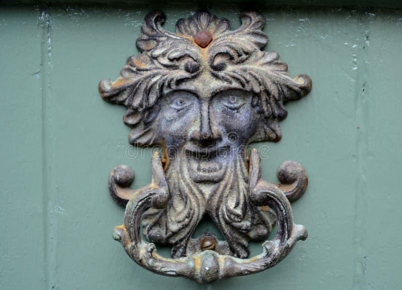 Old metal door knocker stock photo