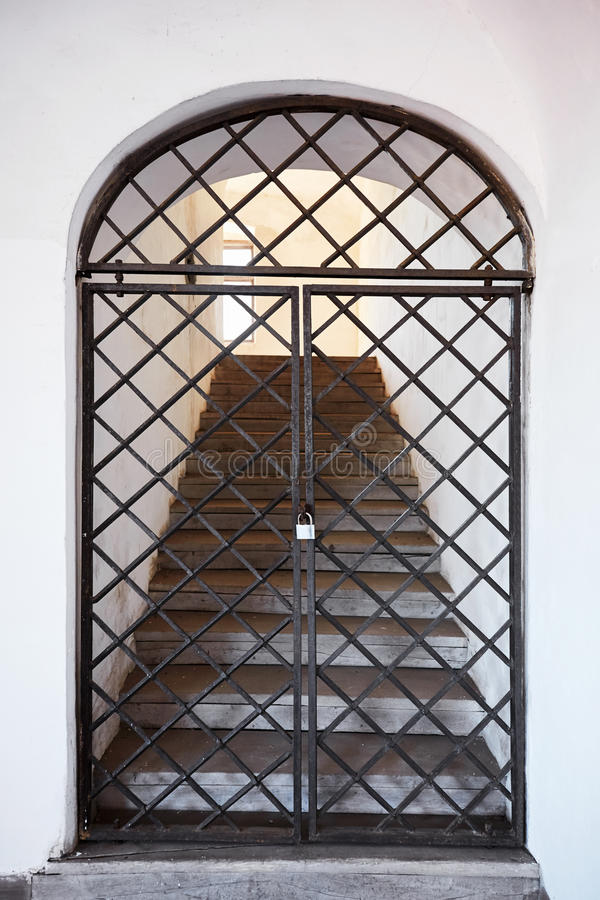 Old metal door in with stairs. Grating.  stock images