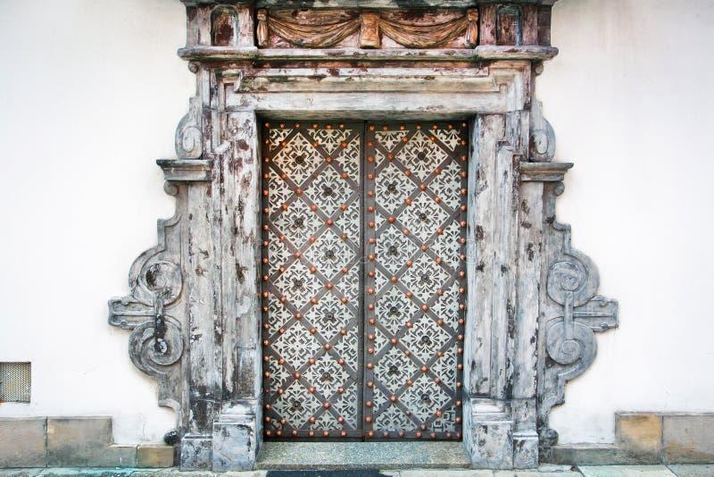 Old metal doors of white building stock photos