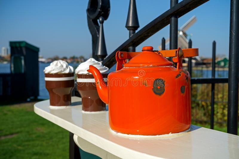 Old metal enamel kettle on fence display royalty free stock image