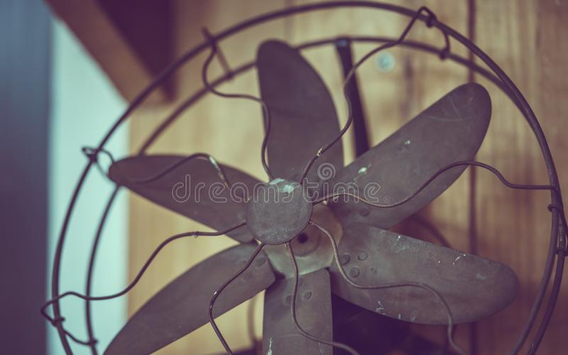 Old metal fan on table royalty free stock image