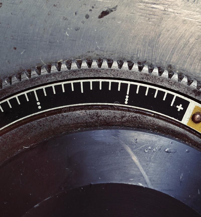 Old metal flywheel with scale.  stock image