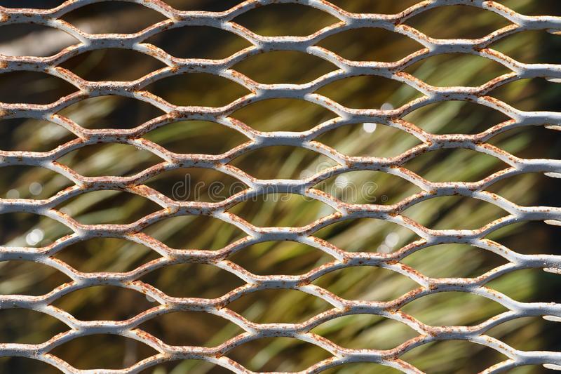 Old metal grid abstract texture, selective focus.  royalty free stock photos