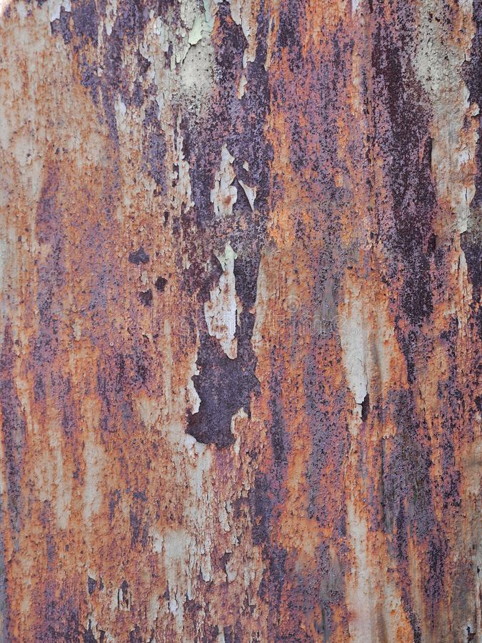 Heavy eroded metal texture with old paint, grunge background royalty free stock images