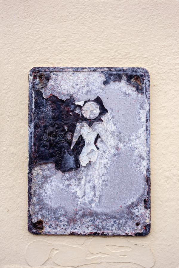 """Old metal plate with sign """"For men"""" on a stucco wall. Close up royalty free stock photos"""