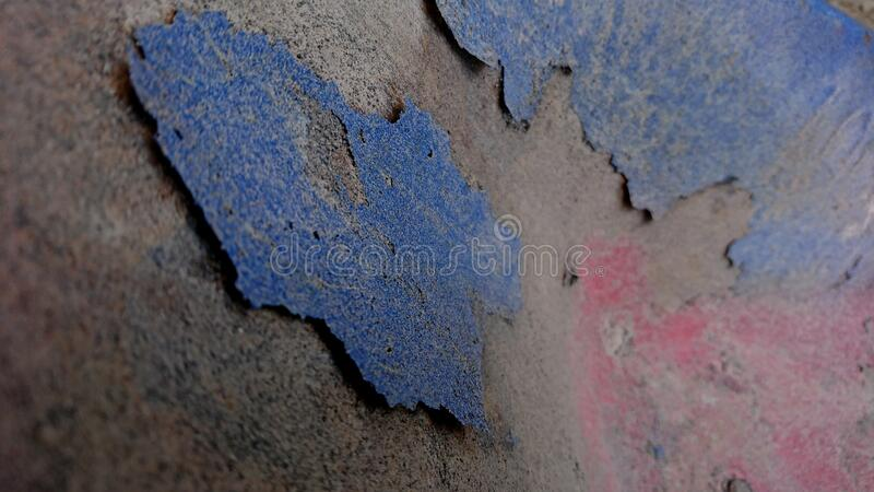 The old metal plate which has peeling paint royalty free stock photo