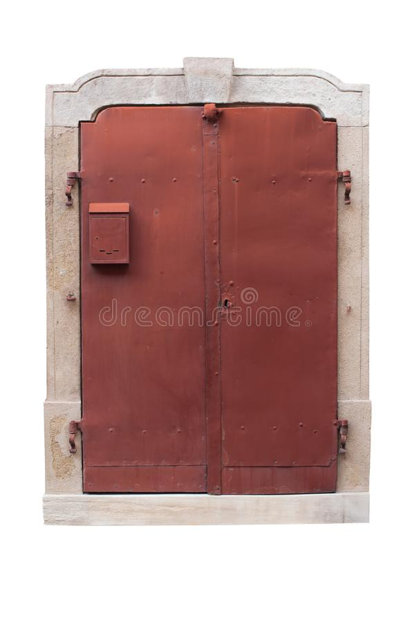 Old metal red doors with stone arch isolated on white background. Red metal doors with small mailbox. Exterior design. Path saved. royalty free stock photo
