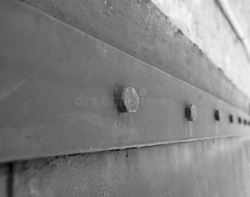 Old metal rivets. On a black-and-white background stock image
