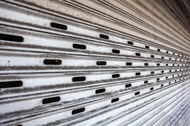 Old metal roller shutter texture background, white color royalty free stock images