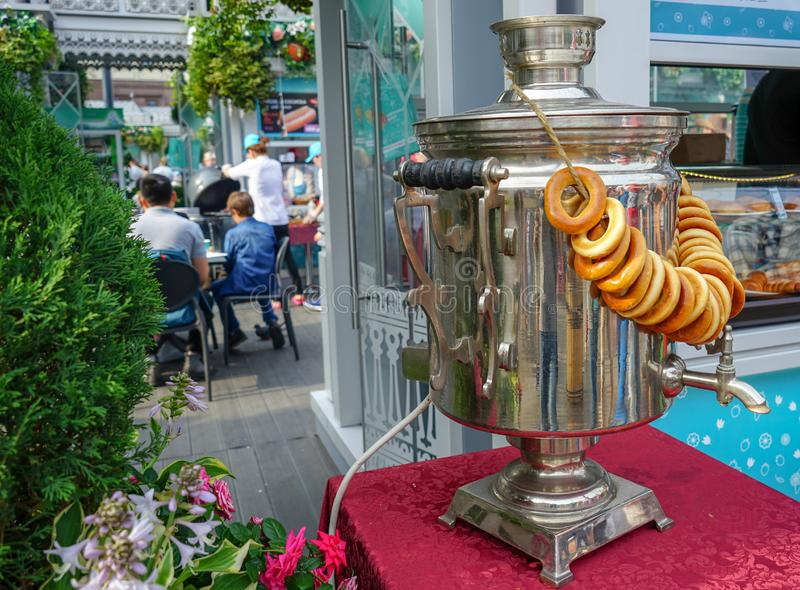 Old metal samovar and a bunch of bagels.  stock photos