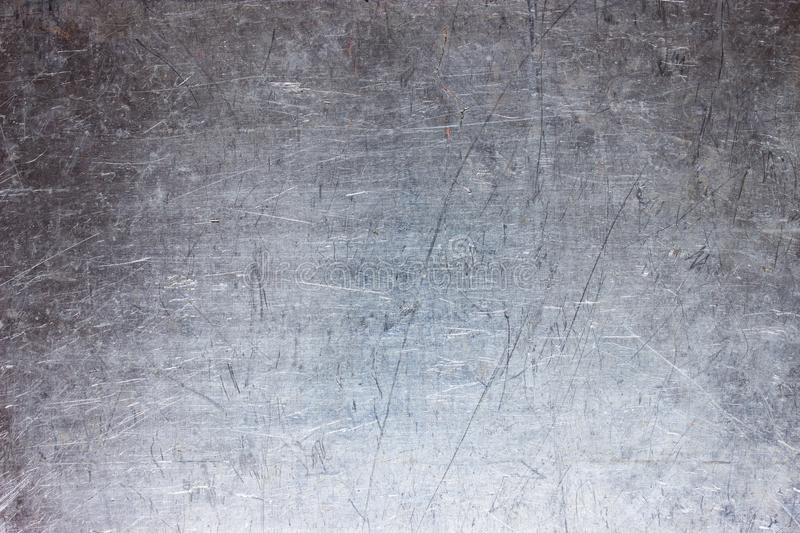 Old metal sheet background, brushed silver surface of iron. Gray steel plate texture, grunge metal background with silvery luster royalty free stock photo