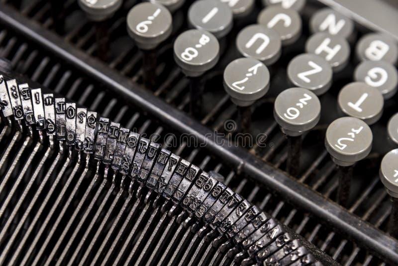 Old metal typewriter. Old classical metal typewriter with round plastic keys stock image