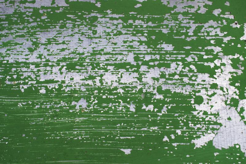 Old metal wall with peeled off paint. royalty free stock photos