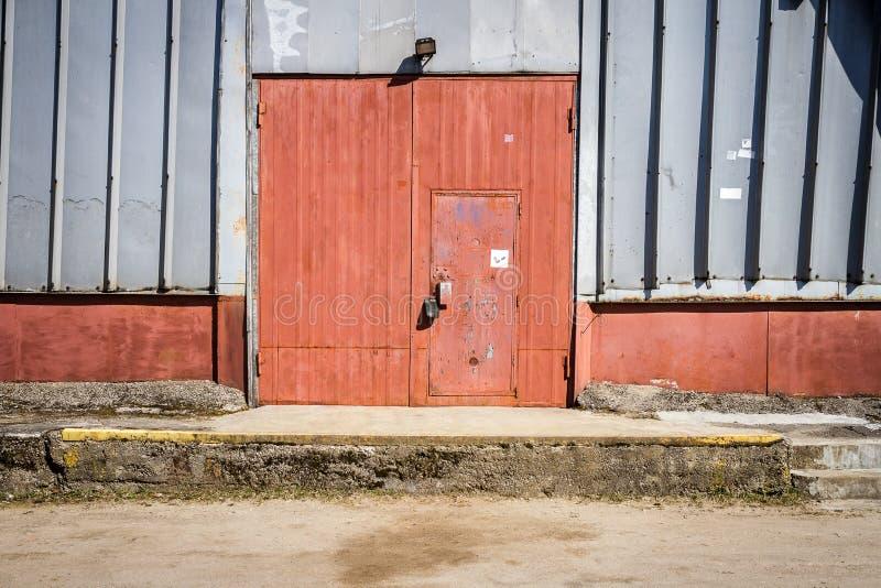 Old metal warehouse door, hangar gate stock image