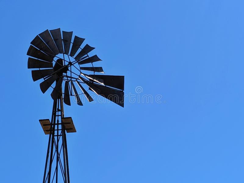 Old Metal windmill. Ingenious. Water generation. Wind Energy. stock images
