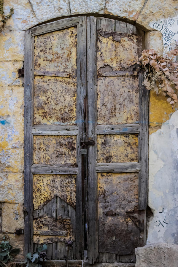 Old metal yellow door with pusty and wood a beautiful vintage background royalty free stock image