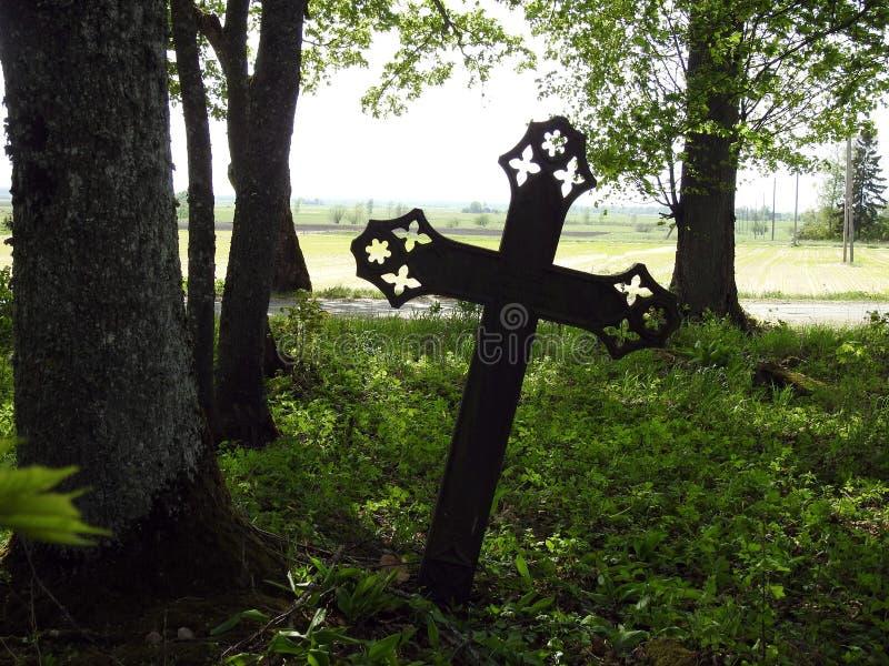 Old metallic cross in graveyard, Lithuania stock photos