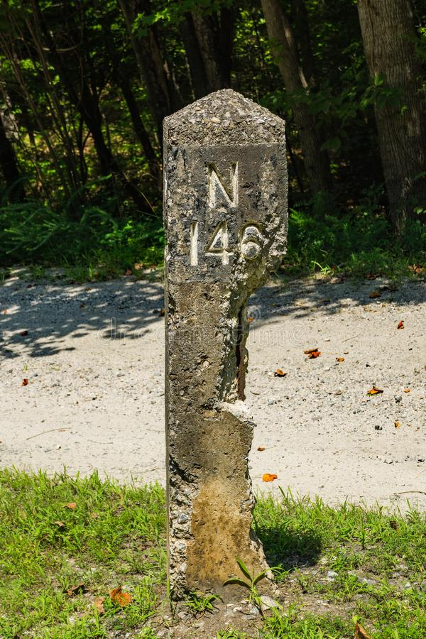 Old Mile Marker on the High Bridge Trail - 2. Farmville, VA – August 16th; Old mile marker on the High Bridge Trail located on the High Bridge Trail State royalty free stock images