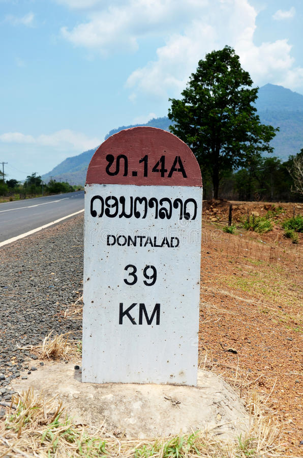 Old Milestone on the road information distance Dontalad with Pakse royalty free stock photos