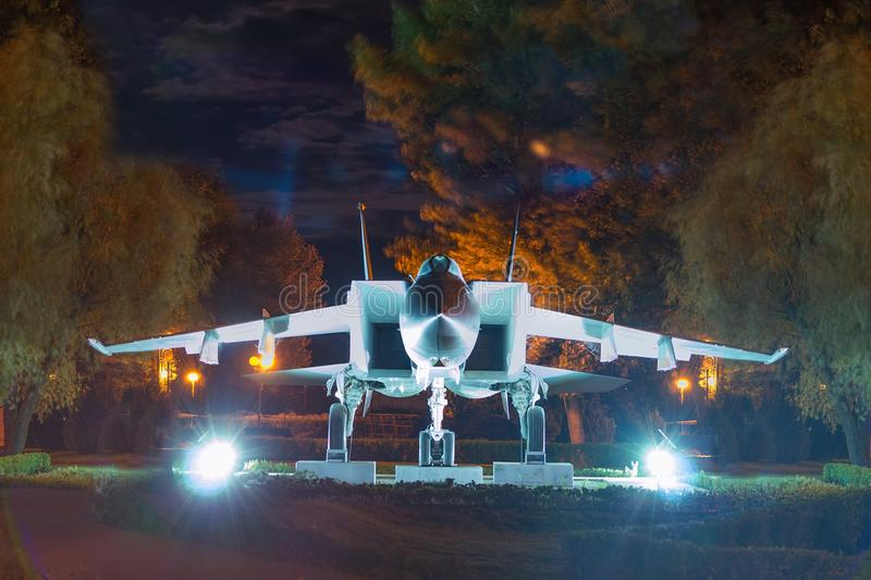 Old military aircraft now stands as a monument. / walk through the night Park royalty free stock images