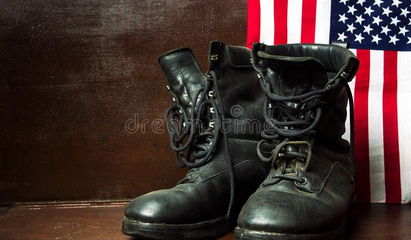 Old military boots and USA flag royalty free stock photos