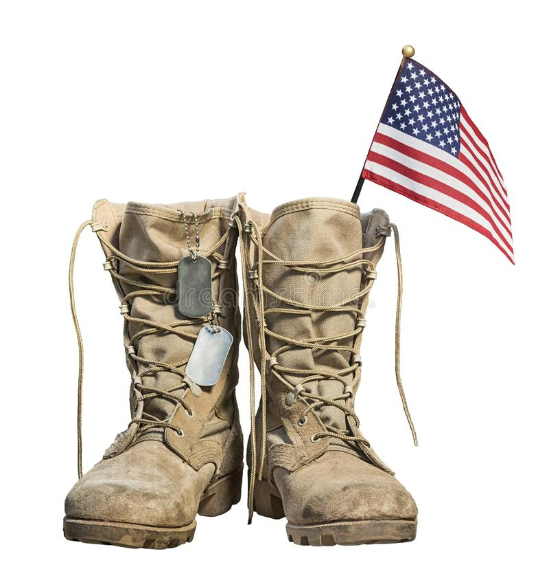Old military combat boots with the American flag and dog tags. Isolated on white background. Memorial Day or Veterans day concept stock images